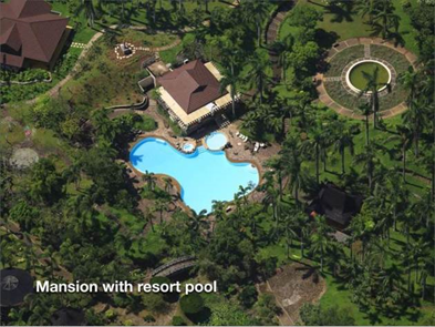 The mansion sits next to a nearby gigantic swimming pool.