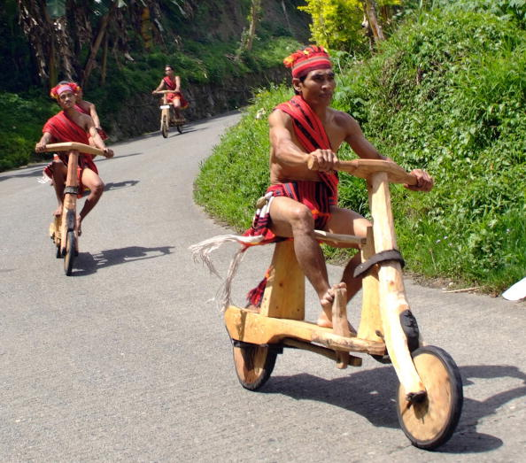 Igorot tribesmen race their wooden scooters in the northern mountainous town of Banaue during a competition on April 16, 2008 as the town celebrates the traditional Imbayah festival, a thanksgiving celebration for its bountiful rice harvests. Colourful parades and the environmentally friendly scooter race are among the highlights of the three-day festival. Igorot tribesmen are well-known master woodcarvers. AFP PHOTO (Photo credit should read AFP/AFP/Getty Images)