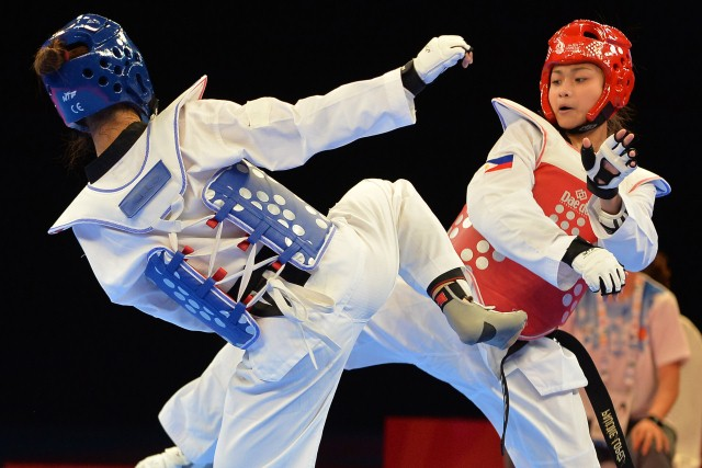 Thi Thu Hien Pham of Vietnam (L) competes against Pauline Louise Lopez of Philippines (R) during the women's under 57kg taekwondo final at the 28th Southeast Asian Games (SEA Games) in Singapore on June 14, 2015. AFP PHOTO / MOHD FYROL