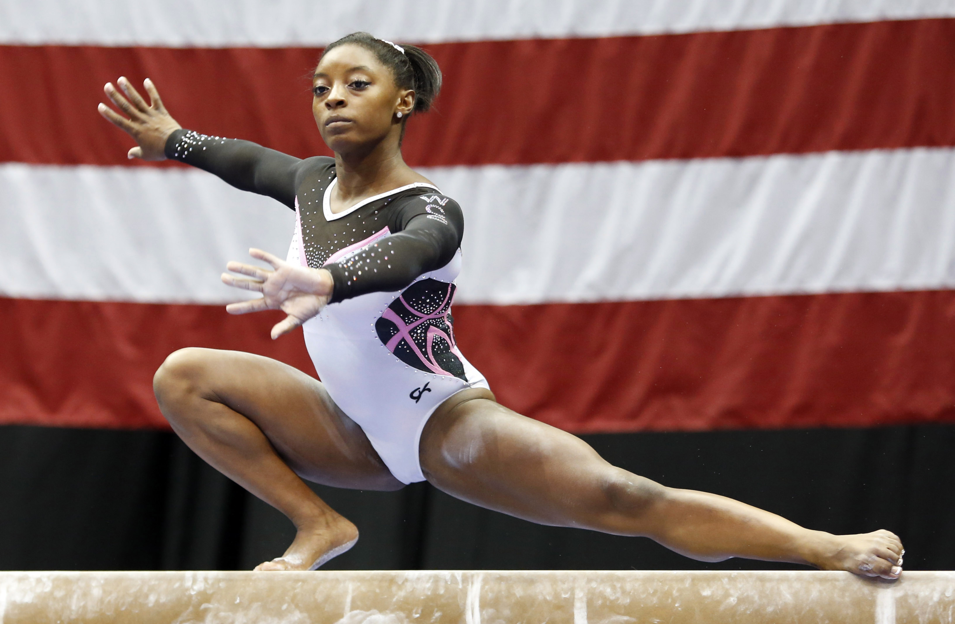 Aug 21, 2014; Pittsburgh, PA, USA; Simone Biles competes on the balance beam in the 2014 P&G Championships at the CONSOL Energy Center. Mandatory Credit: Charles LeClaire-USA TODAY Sports